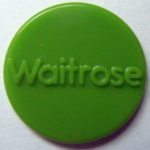 "Cherryguy93 (https://commons.wikimedia.org/wiki/File:Waitrose_token.jpg), ""Waitrose token"", enhanced colour by Iain Cheyne, https://creativecommons.org/licenses/by-sa/4.0/legalcode"