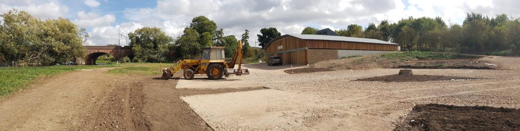 Photo of the new car park at the boathouse plus digger